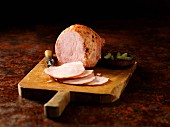 Carved Wiltshire ham on a chopping board