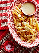Chips with a spicy cheese sauce (Peru)