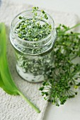 A jar of wild garlic seed pods and salt
