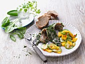 Herb soused herring with a fruity cucumber salad