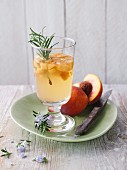 Rosemary tea drink with peaches