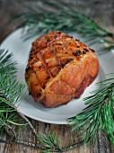 Crispy roast ham with pine sprigs