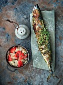 Stuffed grilled mackerel with a vegetables salad