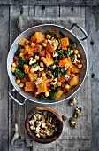 A pumpkin and spinach medley with chickpeas and walnuts