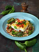 Cod on white beans with peppers