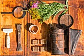 An arrangement of wild flowers and an antique tools (seen from above)