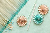 Pastel origami flowers, drinking straws & party picks for decorating table