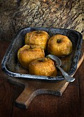 Baked apples in an old baking tin