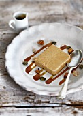 A slice of coffee parfait with caramel sauce