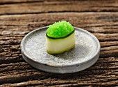 Gunkan maki sushi with green caviar