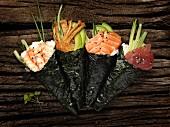 Temaki sushi with salmon, tuna fish, chicken and prawns