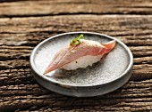 Nigiri sushi with fried tuna fish