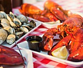Cooked lobster and mussels on serving platters
