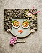 The face of a Japanese woman made from sushi and nori