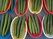 Cucumbers in plastic baskets