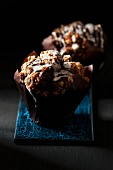 Chocolate muffins with crispy oat crumble and white icing
