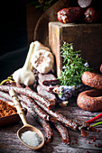 An arrangement of smoked and dried red venison sausages