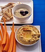 Various dips with carrot sticks and unleavened bread