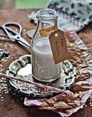 A bottle of homemade oat milk