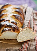 A plaited loaf sprinkled with icing sugar