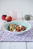 Summer salad with tomatoes, white peaches, mozzarella and balsamic cream