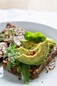 Avocado salad on gluten-free seed and nut bread