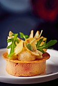Goose liver with chestnuts, pears and rocket