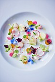 Scallops with radishes and edible flowers