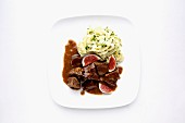 Beef ragout with allspice, figs and parsley pasta