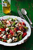 Herb salad with strawberries, blue cheese and walnuts