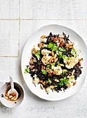 Wild rice pilaf with cauliflower, burnt butterand almonds