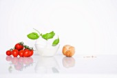 An arrangement of tomatoes, mozzarella, basil and bread
