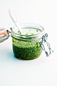 Homemade basil pesto in a flip-top jar