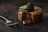Mini chocolate cake with a liquid core garnished with blackberries