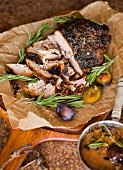 Roast ham with rosemary and plums