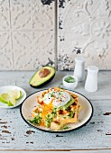 Parmesan waffles with avocado cream and a poached egg