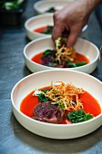 Tuna and hamachi tatar in gazpacho with baby bok choy and frisee lettuce