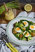 Asparagus salad with potatoes, broccoli, hard-boiled eggs and sauce Hollandaise