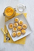 Lemon cream cookies with a jar of lemon curd