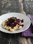 Ricotta gnocchi with beetroot and poppyseeds
