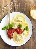 Mezzelune ripiene with tomato sauce