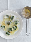 Rotolo filled with spinach and butter sauce