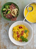 Tagliolini with yellow peppers and Perciatelli alla Pugliese