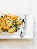 Fish steak with roasted root vegetables and thyme