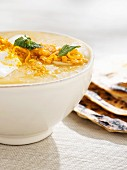 Pumpkin soup with grated cheese and naan bread