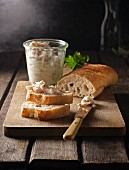 Homemade lard on baguette bread and in a glass