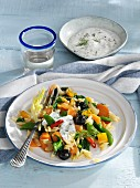 Carrot and vegetables medley with rice pasta and dill yoghurt
