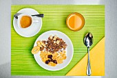 A breakfast of muesli, espresso and orange juice (seen from above)