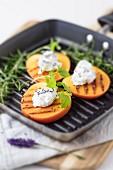 Grilled persimmon with goat's cheese cream and herbs