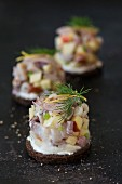 Soused herring salad on pumpernickel